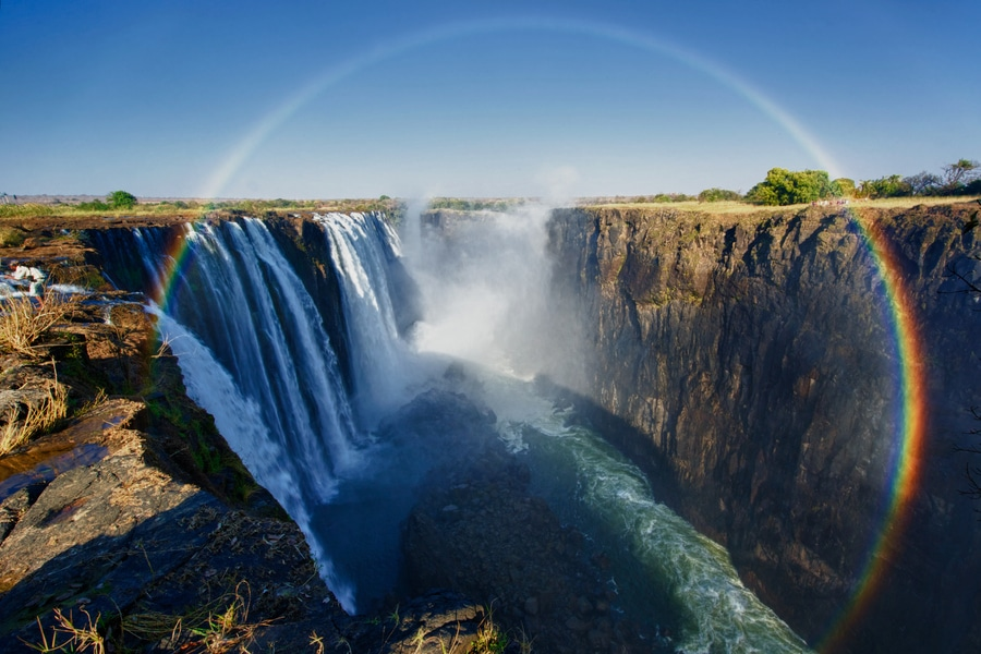Victoria Falls at Zambia-Zimbabwe border with rainbow arch